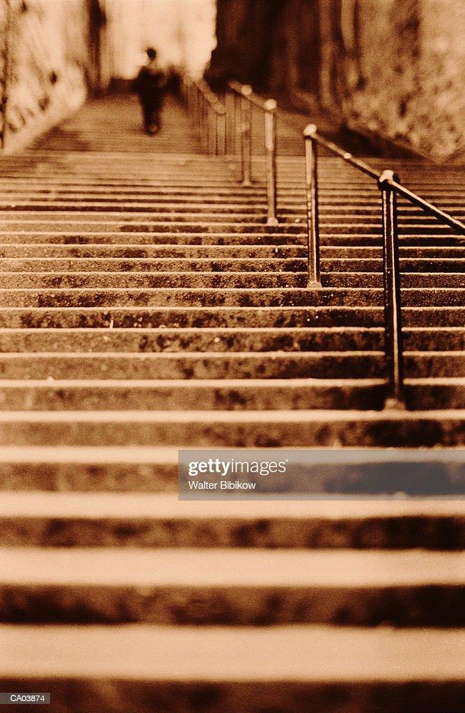 Scotland, Edinburgh, person climbing steps (sepia, focus on center) : Stock Photo
