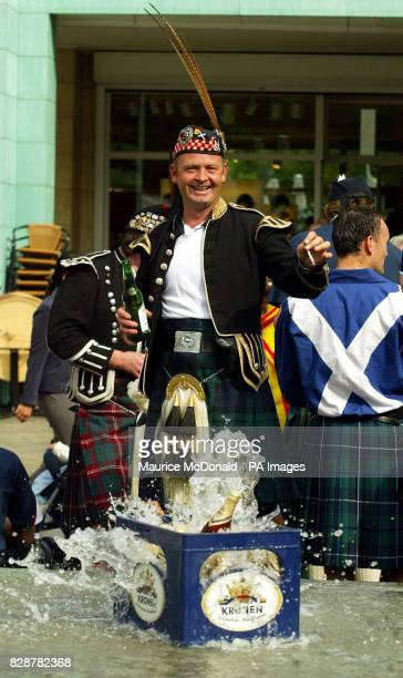 A Scotland fan drinks in the City centre of Dortmund before tomorrow's Euro 2004 Qualifying Match against Germany