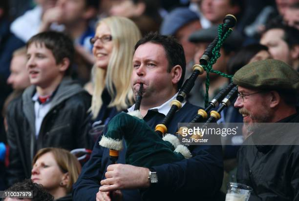 Scotland fan plays the bagpipes during the RBS 6 Nations Championship match between England and Scotland at Twickenham Stadium on March 13 2011 in...