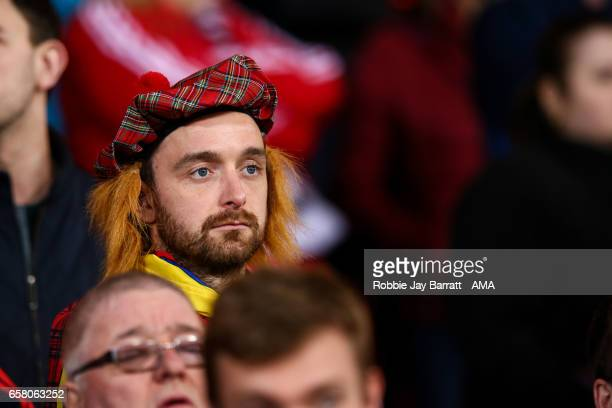 Scotland fan watches on during the FIFA 2018 World Cup Qualifier between Scotland and Slovenia at Hampden Park on March 26 2017 in Glasgow Scotland