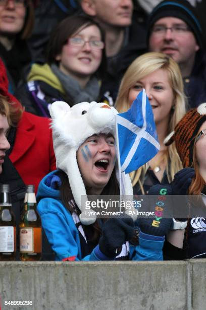 A Scotland fan waves a flag in the stands