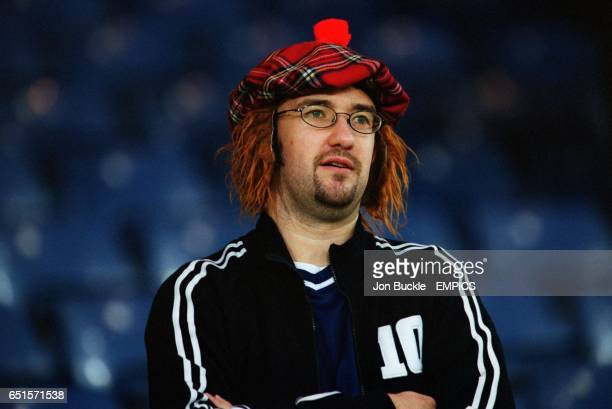 A Scotland fan wearing the traditional tam o' shanter and ginger wig