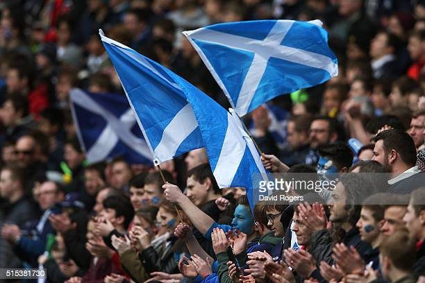 Scotland fans cheer on their team during the RBS Six Nations match between Scotland and France at Murrayfield Stadium on March 13 2016 in Edinburgh...