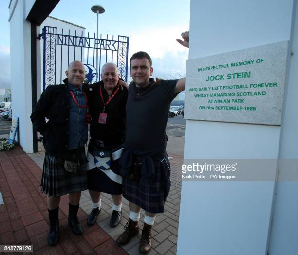 Scotland fans Gary McNamara Jim Cooper Bruce Giles at the Ninian Park Gates with the plaque in memory of former Scotland Manager Jock Stein during...