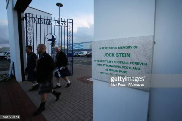Scotland fans Gary McNamara Jim Cooper Bruce Giles walk past the old Ninian Park Gates with the plaque in memory of former Scotland Manager Jock...