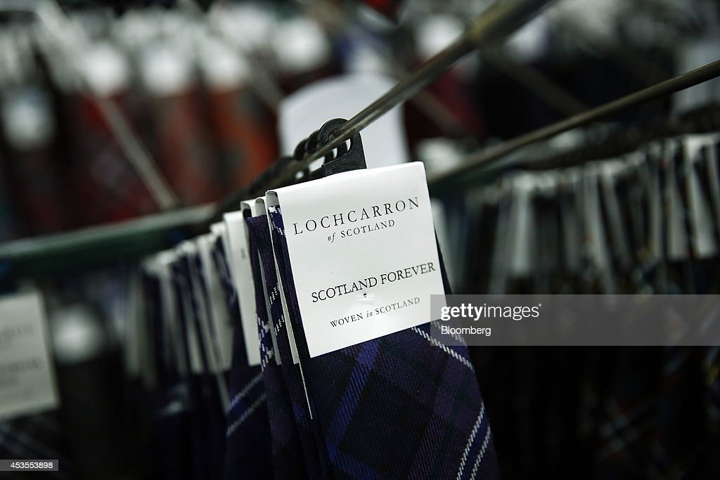 A 'Scotland Forever' logo sits on a completed tartan neck tie as it hangs in the storehouse following completion at Lochcarron John Buchan Ltd.'s production plant in Selkirk, U.K., on Tuesday, Aug. 12, 2014. Scottish nationalists seeking independence from the U.K. lost ground in the latest poll of voting intentions for the Sept. 18 referendum, as campaigners to keep the 307-year-old U.K. intact extended their lead. Photographer: Simon Dawson/Bloomberg via Getty Images