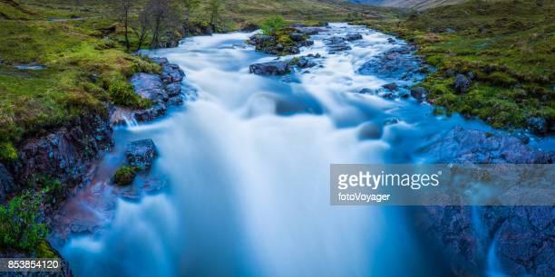 Scotland Glen Etive waterfall cascading down Highlands mountain river rapids