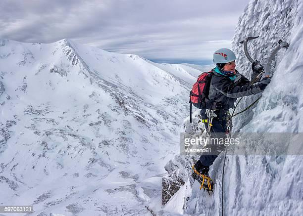 UK, Scotland, Glencoe, West Face Aonach Mor, woman ice climbing