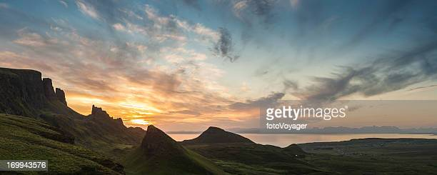 Scotland glorious sunrise panorama over Quiraing mountain pinnacles