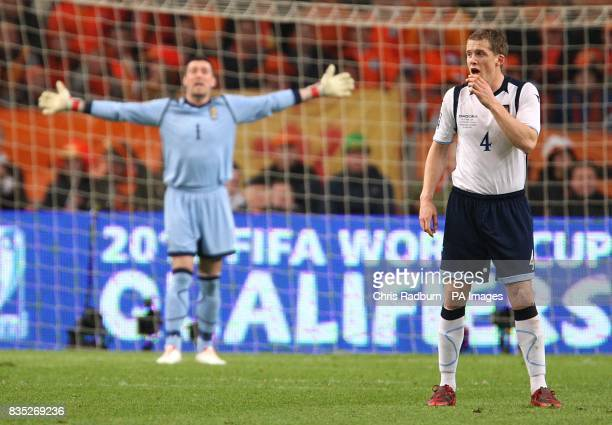 Scotland goalkeeper Allan McGregor and teammate Christophe Berra stand frustrated at the Amsterdam ArenA