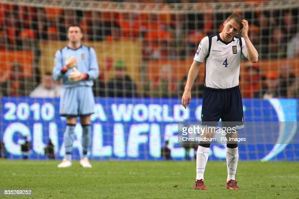 Scotland goalkeeper Allan McGregor and teammate Christophe Berra stand dejected at the Amsterdam ArenA