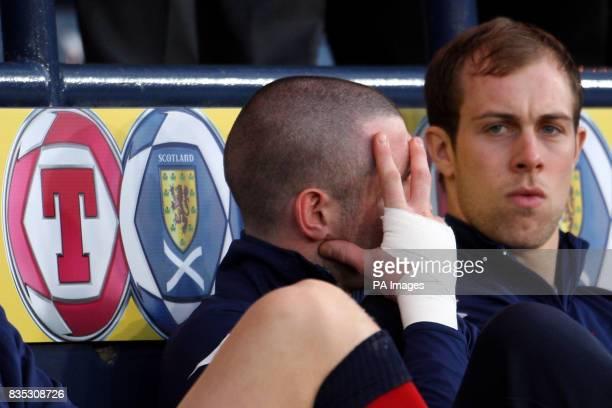 Scotland goalkeeper Allan McGregor gestures on the bench