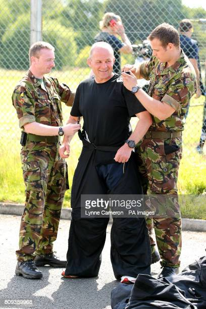 Scotland head coach Andy Robinson is placed in bomb disposal equipment during a training session with the Army at the HQ2 Division in Edinburgh