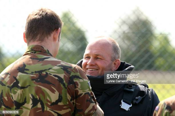 Scotland head coach Andy Robinson is placed in bomb disposal equipment