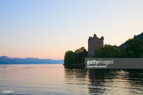 Scotland, Highland, Urquhart Castle on shores of Loch Ness at sunset