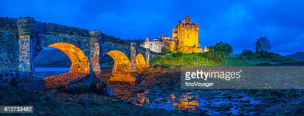 Scotland iconic Highlands glen battlements of Eilean Donan castle illuminated
