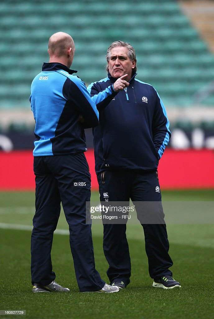 Scotland interim head coach Scott Johnson (R) inspects the pitch prior to the RBS Six Nations match between England and Scotland at Twickenham Stadium on February 2, 2013 in London, England.