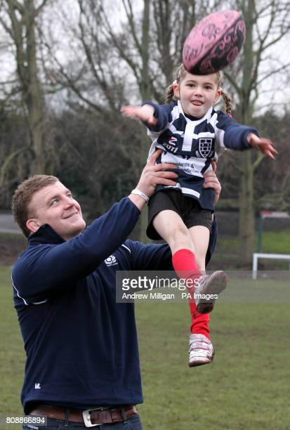 Scotland international Moray Low and three year old Louisa Hamilton during the announcement at Musselburgh Rugby Club of a significant investment...