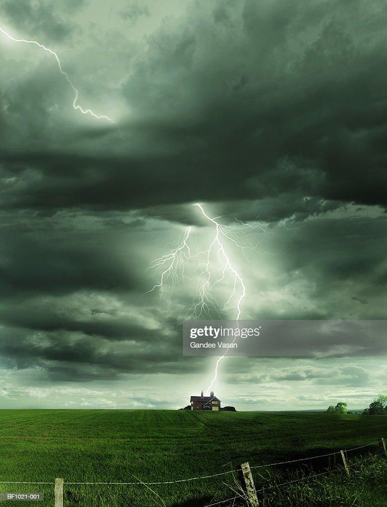 Scotland, Inverness, lightning striking isolated house : Stock Photo