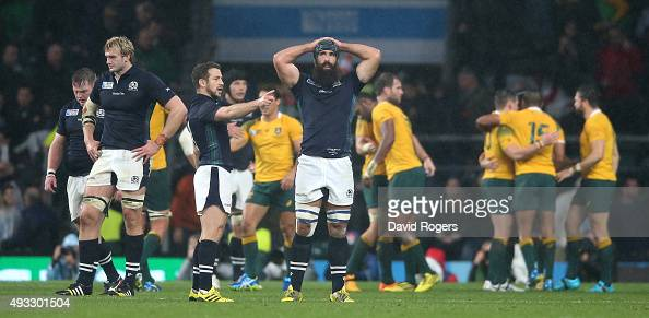 Scotland look dejected after their defeat during the 2015 Rugby World Cup Quarter Final match between Australia and Scotland at Twickenham Stadium on...