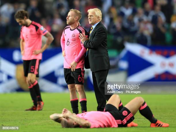 Scotland manager Gordon Strachan commiserates with Barry Bannan after the final whistle during the 2018 FIFA World Cup Qualifying Group F match at...