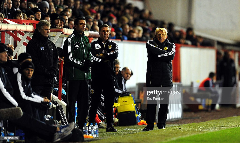 Scotland manager <a gi-track='captionPersonalityLinkClicked' href=/galleries/search?phrase=Gordon+Strachan&family=editorial&specificpeople=243133 ng-click='$event.stopPropagation()'>Gordon Strachan</a> (r) looks on during the International Friendly match between Scotland and Estonia at Pittodrie Stadium on February 6, 2013 in Aberdeen, Scotland.