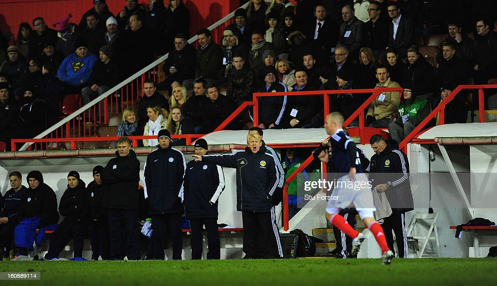 Scotland manager Gordon Strachan (c) looks on during the International Friendly match between Scotland and Estonia at Pittodrie Stadium on February 6, 2013 in Aberdeen, Scotland.