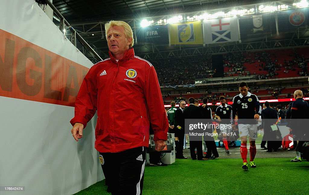 Scotland manager <a gi-track='captionPersonalityLinkClicked' href=/galleries/search?phrase=Gordon+Strachan&family=editorial&specificpeople=243133 ng-click='$event.stopPropagation()'>Gordon Strachan</a> walks down the tunnel after the International Friendly match between England and Scotland at Wembley Stadium on August 14, 2013 in London, England.