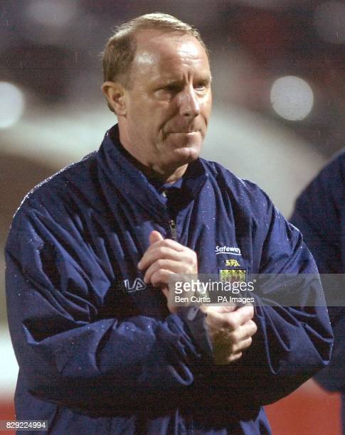 Scotland manger Bertie Vogts walks off as the team suffer a 20 defeat at the Portugal v Scotland International Challenge match at the Estadio...
