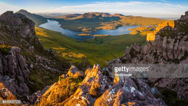 Scotland mountain sunrise over remote Highland peaks glens lochs Coigach