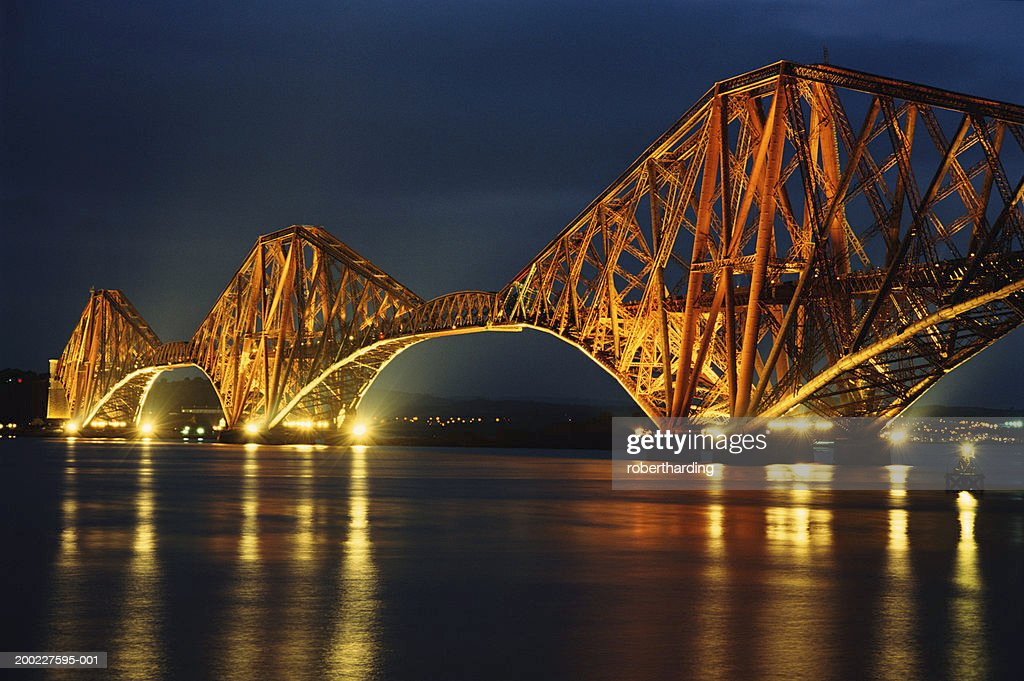 Scotland, near Edinburgh, Forth Railway Bridge illuminated at night : Stock Photo