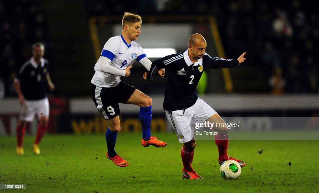 Scotland player <a gi-track='captionPersonalityLinkClicked' href=/galleries/search?phrase=Alan+Hutton&family=editorial&specificpeople=839355 ng-click='$event.stopPropagation()'>Alan Hutton</a> (r) is challenged by Tarmo Kink of Estonia during the International Friendly match between Scotland and Estonia at Pittodrie Stadium on February 6, 2013 in Aberdeen, Scotland.