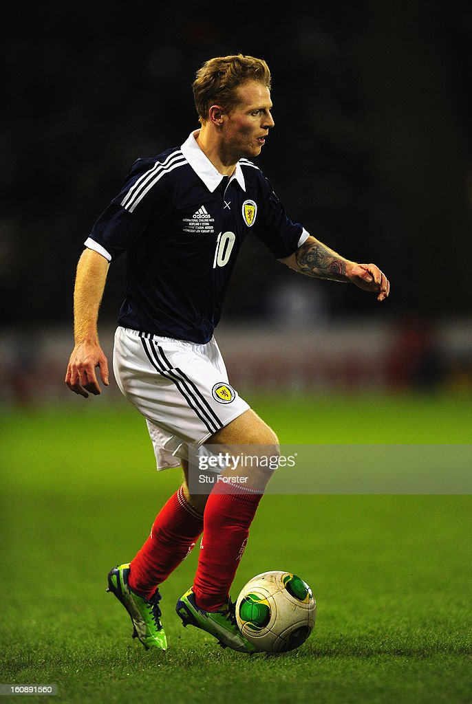 Scotland player Chris Burke in action during the International Friendly match between Scotland and Estonia at Pittodrie Stadium on February 6, 2013 in Aberdeen, Scotland.