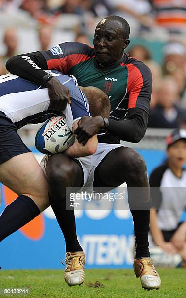 Scotland player Chris Fusaro tackles Kenya player Humphrey Kayange during the Kenya versus Scotland match at the Hong Kong Rugby Sevens tournament on...