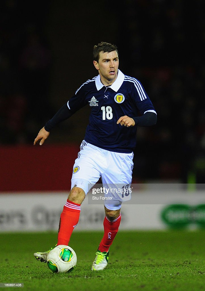 Scotland player James McArthur in action during the International Friendly match between Scotland and Estonia at Pittodrie Stadium on February 6, 2013 in Aberdeen, Scotland.