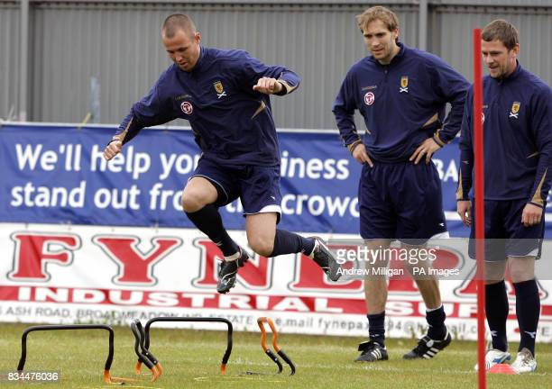 Scotland player Kenny Miller with Russell Anderson and Gary Naysmith during the training session at Strathclyde Homes Stadium Dumbarton