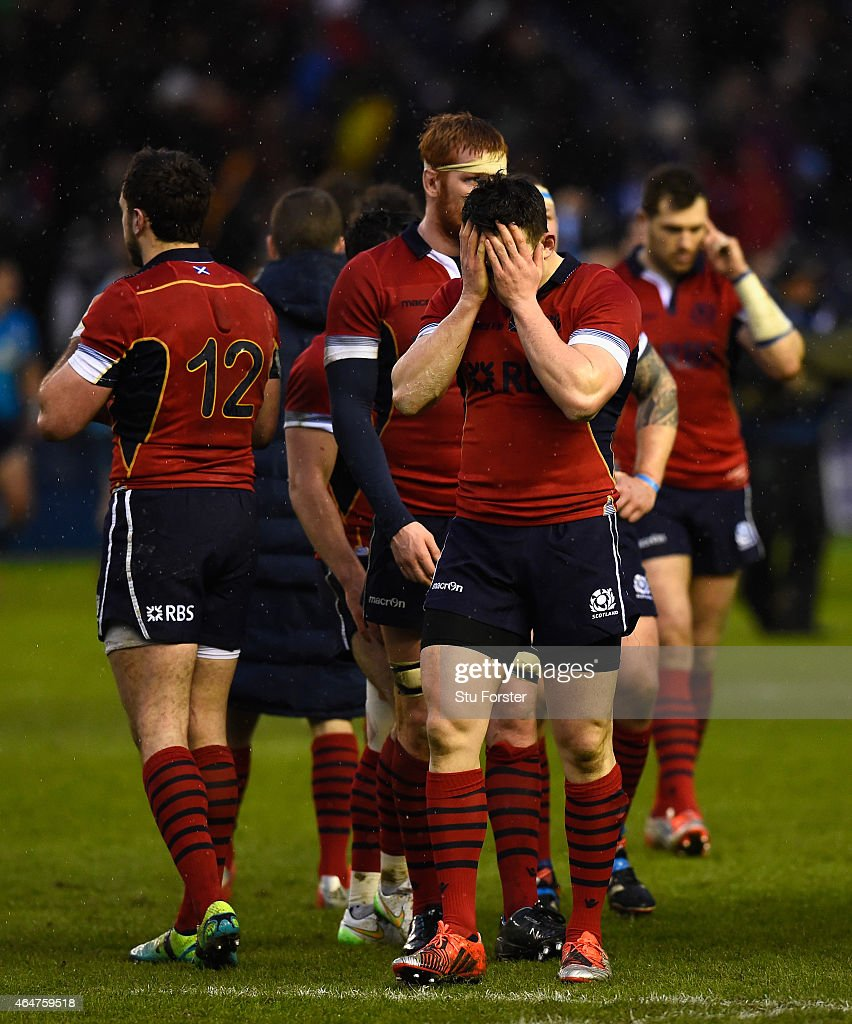 Scotland player <a gi-track='captionPersonalityLinkClicked' href=/galleries/search?phrase=Matt+Scott+-+Rugby+Union+Player&family=editorial&specificpeople=15066775 ng-click='$event.stopPropagation()'>Matt Scott</a> (r) reacts as team mates look on after the RBS Six Nations match between Scotland and Italy at Murrayfield Stadium on February 28, 2015 in Edinburgh, Scotland.