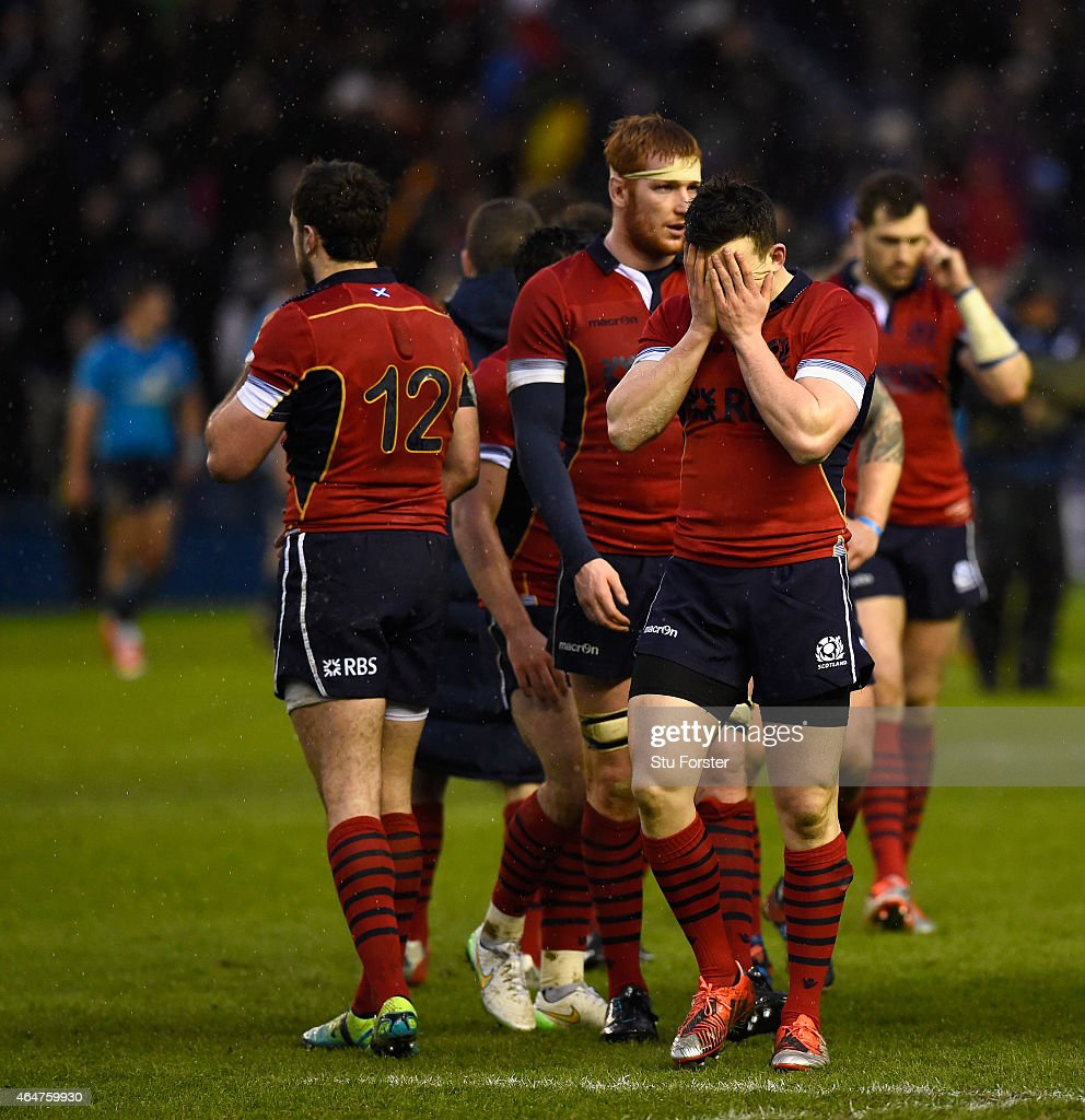 Scotland player <a gi-track='captionPersonalityLinkClicked' href=/galleries/search?phrase=Matt+Scott+-+Rugby+Union+Player&family=editorial&specificpeople=15066775 ng-click='$event.stopPropagation()'>Matt Scott</a> (c) reacts as team mates look on after the RBS Six Nations match between Scotland and Italy at Murrayfield Stadium on February 28, 2015 in Edinburgh, Scotland.