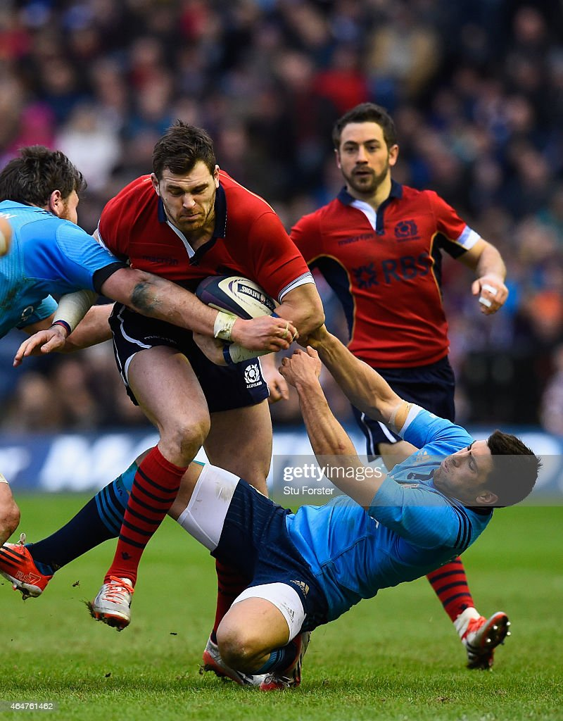 Scotland player Sean Lamont is stopped by Italy scrum half Edoardo Gori during the RBS Six Nations match between Scotland and Italy at Murrayfield...
