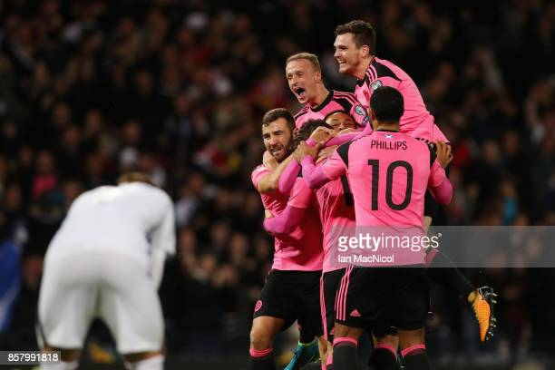 Scotland players celebrate as Martin Skrtel of Slovakia scores an own goal for their first goal during the FIFA 2018 World Cup Group F Qualifier...