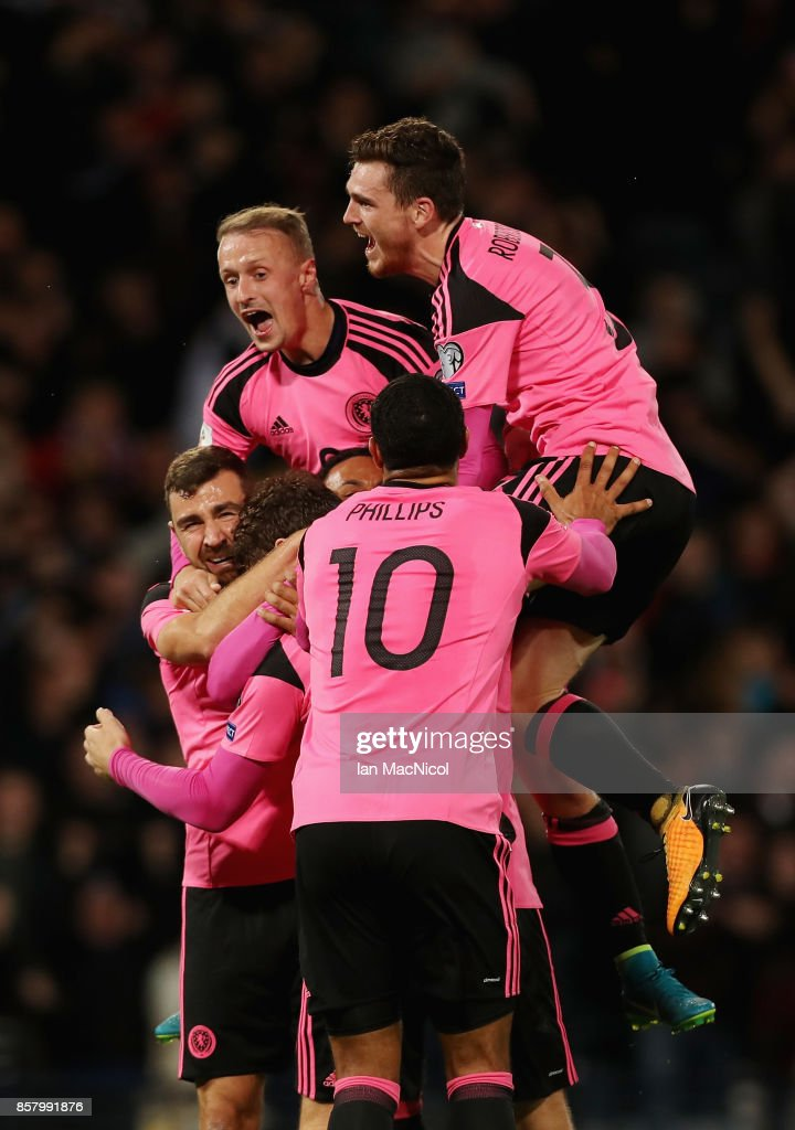Scotland players celebrate as Martin Skrtel of Slovakia scores an own goal for their first goal during the FIFA 2018 World Cup Group F Qualifier between Scotland and Slovakia at Hampden Park on October 5, 2017 in Glasgow, Scotland.