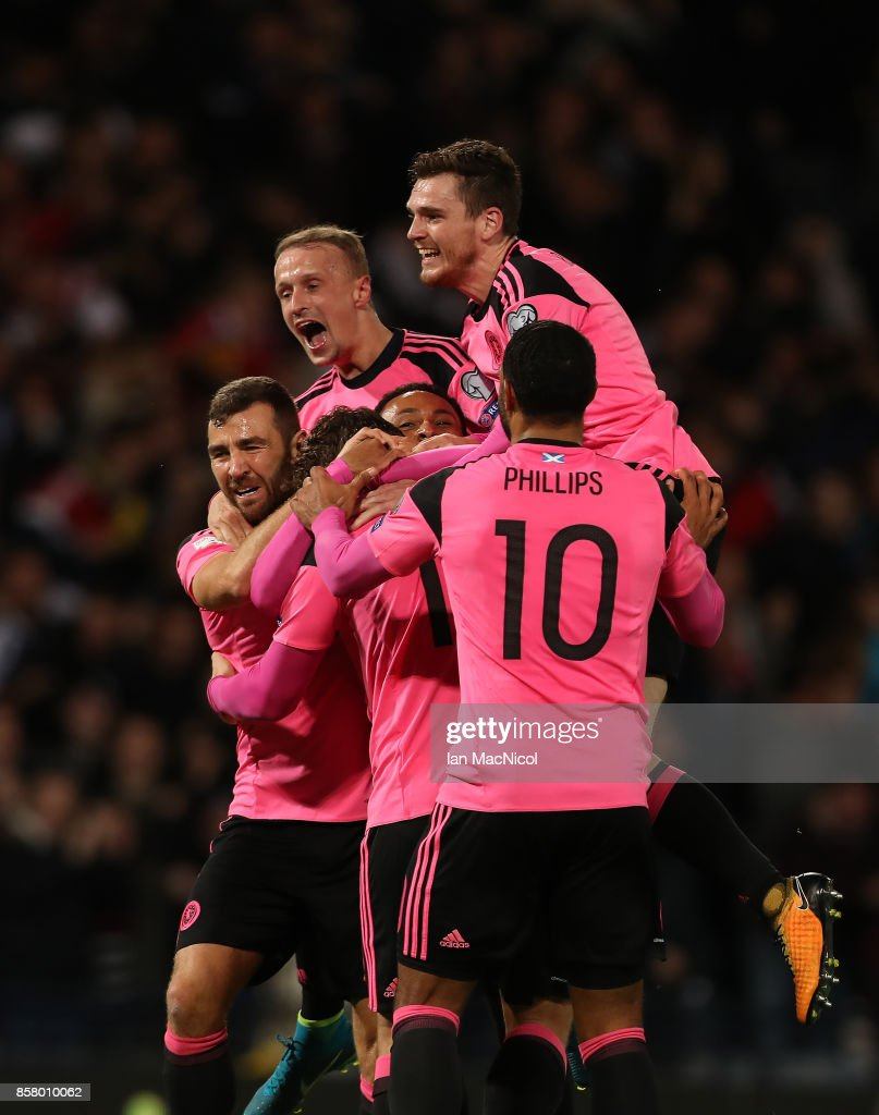 Scotland players celebrates after Martin Skrtel of Slovakia scores in his own net during the FIFA 2018 World Cup Qualifier between Scotland and Slovakia at Hampden Park on October 5, 2017 in Glasgow, Scotland.