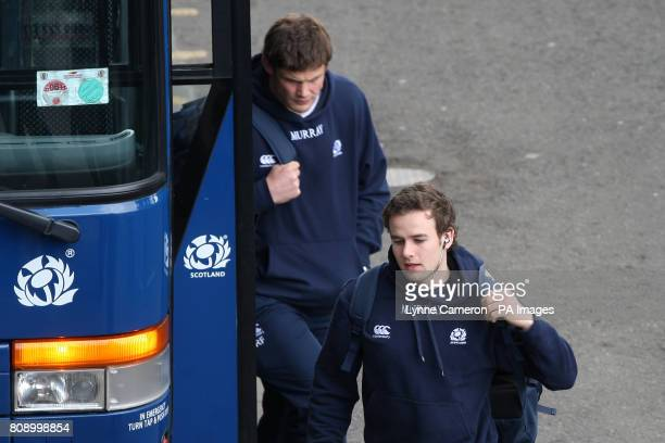 Scotland players Ross Ford and Ruaridh Jackson alight the team bus and make their way into the stadium for the game