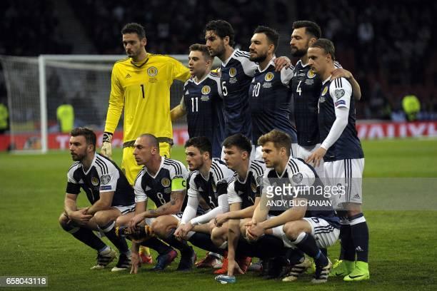Scotland players Scotland's goalkeeper Craig Gordon Scotland's midfielder James Forrest Scotland's defender Charlie Mulgrew Scotland's forward Robert...