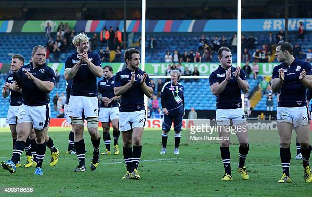 Scotland players take the applause from the crowd at the end of the game during the 2015 Rugby World Cup Pool B match between Scotland and USA at...