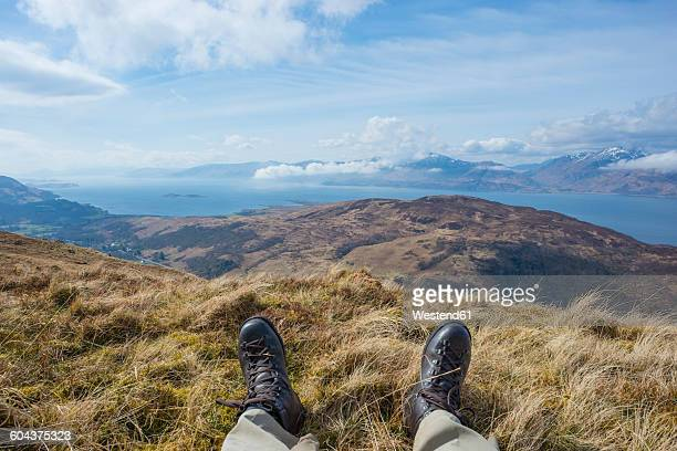 UK, Scotland, Scottish Highlands, Glencoe, resting hiker on top of a mountain