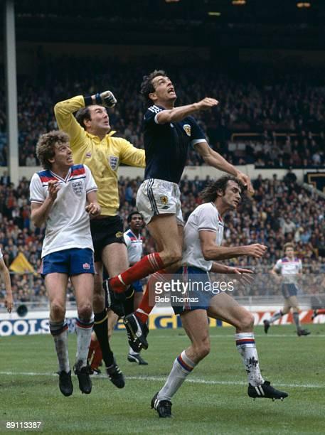 Scotland striker Joe Jordan jumps higher than England goalkeeper Joe Corrigan and defenders Graham Rix and Dave Watson during the British...
