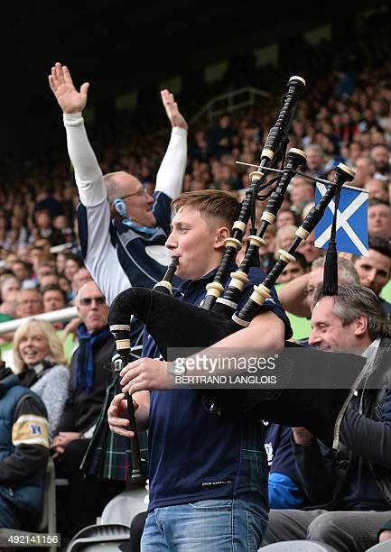 A scotland supporter gestures as another plays the bagpipes during a Pool B match of the 2015 Rugby World Cup between Scotland and Samoa at St James'...