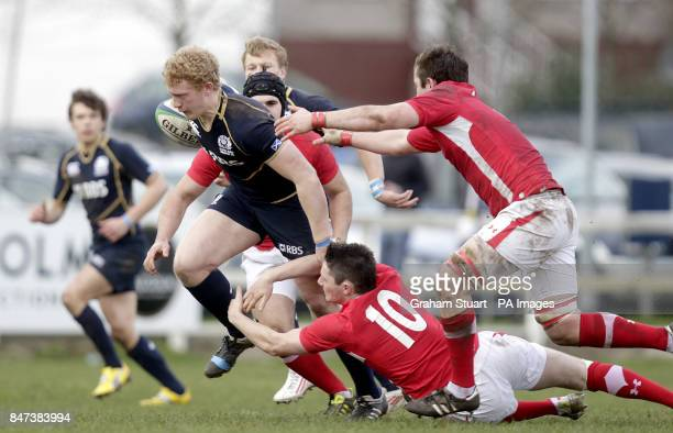 Scotland under 18's Frankie Robson is tackled by Wales under 18's Jack Maynard during the Under 18's match at Braidholm Glasgow