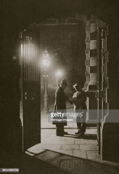 Scotland Yard in the early hours of the morning the Embankment London 20th century The constable on duty is conferring with a plainclothed policeman...